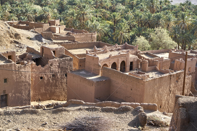 View of the ruins of the Kasbah of Tiliouine located in a palm oasis near Agdz, Morocco
