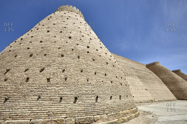 Stone fortress walls of the Ark of Bukhara in the city of Bukhara, Uzbekistan