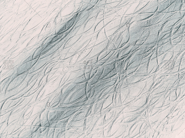Aerial view of off-piste ski traces on the Monte Bianco, Courmayeur, Aosta Valley, Italy.