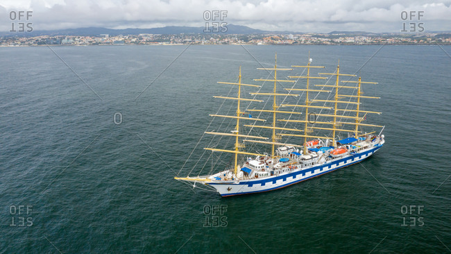 Lisbon, Portugal - May 1, 2020: Aerial view of Royal Clipper anchored off the coast of Cascais during Covid-19 pandemic. The sailboat was waiting to come to shore.