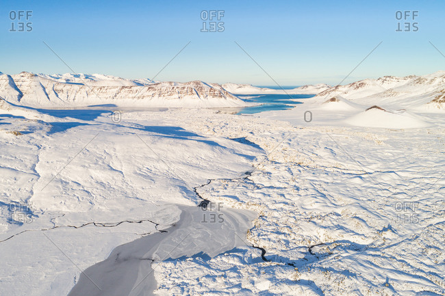 Aerial view of lakes and mountains, covered with a thick layer of snow, Snaefellsnes, Iceland