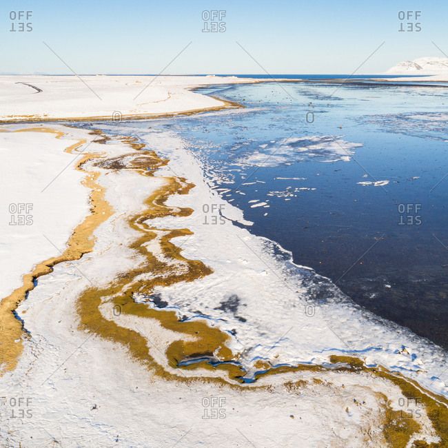 Abstract aerial view of coastline with snow and ice in winter, Grundarfjordur, Snaefellsnes, Iceland