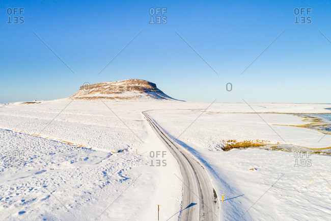 Aerial view of road and mountain in a snow-covered landscape in winter, Snaefellsnes, Iceland