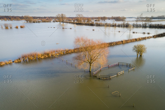 Aerial view of fenced water at submerged floodplains along the river IJssel during a period of high water, Netherlands