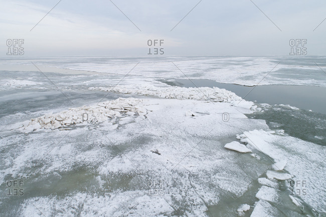 Aerial view of ice and ice shove on the frozen lake Markermeer after a long period of frost in winter, Noord-Holland, Netherlands
