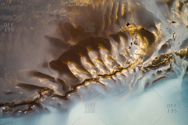 Abstract aerial view of sandbanks and shallow water in a lake, looking like a luminous skeleton in the water, Sprengisandur, highlands of Iceland