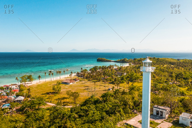 Aerial view of lighthouse on white sand Langob Beach in Malapascua Island, Province of Cebu, Philippines.