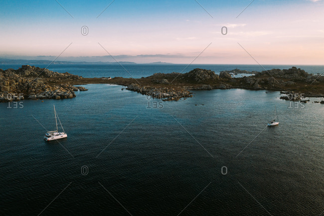 Aerial view of two sail boats anchored at Lavezzu Island, Corsica, France.