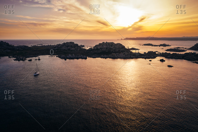 Aerial view of single sail boat anchored at Lavezzu Island, Corsica, France.