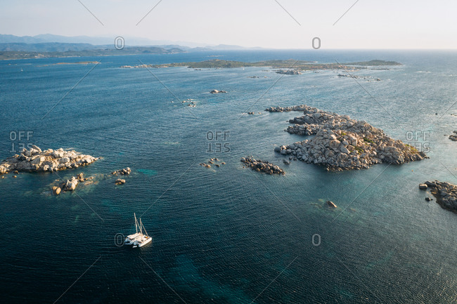 Aerial view of two catamarans anchored together at Lavezzu Island, Corsica, France.