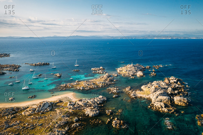 Aerial view of group of sail boats anchored at Lavezzu Island, Corsica, France.