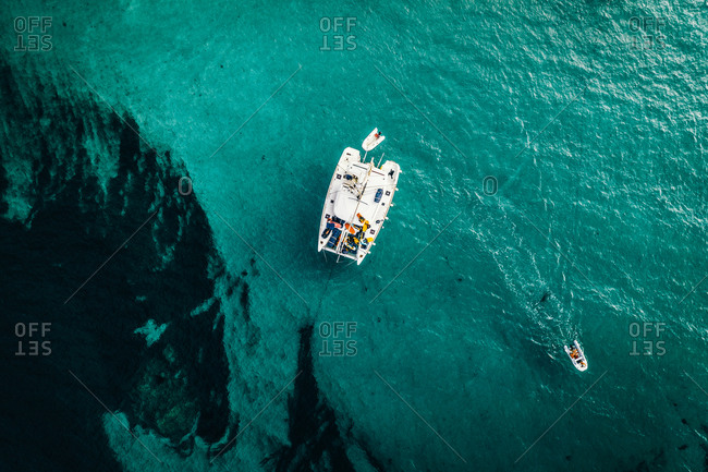 Aerial view of a catamaran anchored and a digny at Lavezzu Island, Corsica, France.