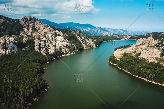 Aerial view of lake de  in between the mountains of Agnarone, Corsica, France.