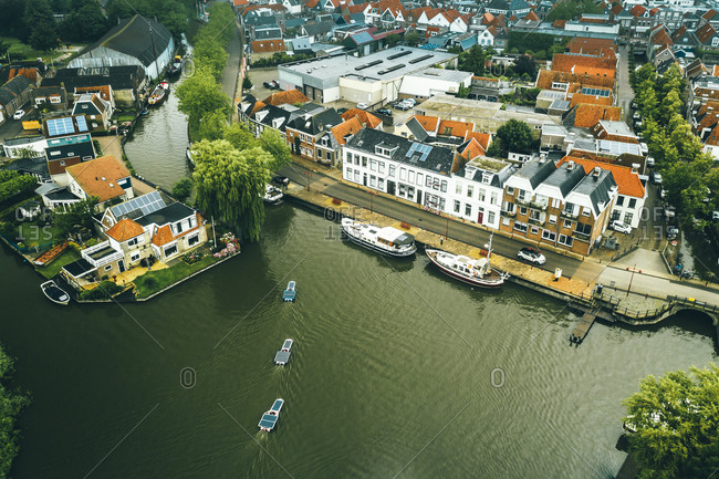 July 8, 2020: Aerial view of solar panel boats navigating through the city of Bolsward, Friesland, The Netherlands.
