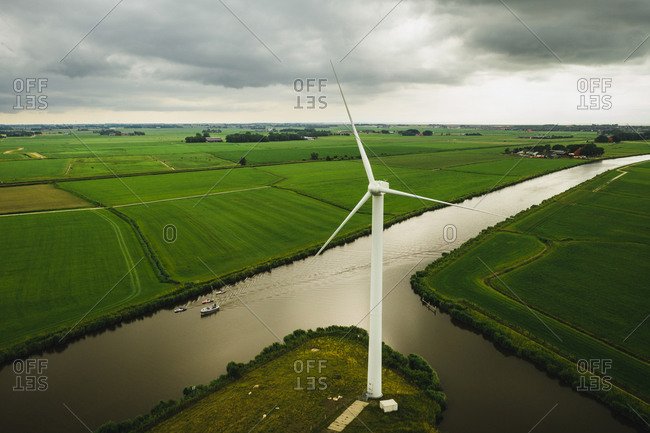 Aerial view of solar panel boats navigating through the farmlands in Harlingen, Friesland, The Netherlands.