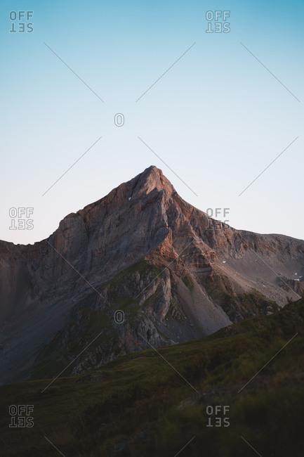 Rocky mountain peak just before sunrise