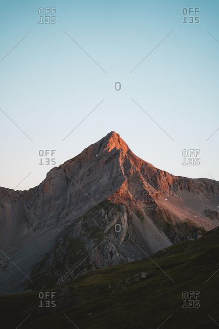 Rocky mountain north face illuminated during sunrise
