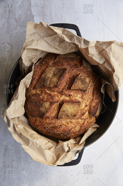 Freshly baked sourdough bread in a pot straight out of the oven