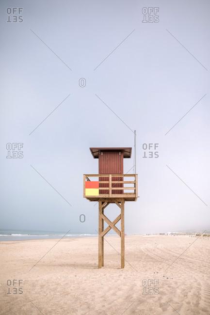 Surveillance house on a nice beach on a cloudy day