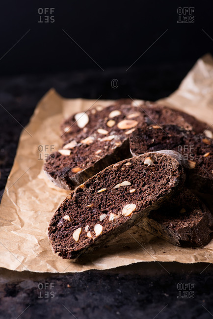Dark chocolate biscotti with nuts on baking paper