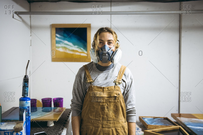 Portrait of female resin artist in homemade art studio