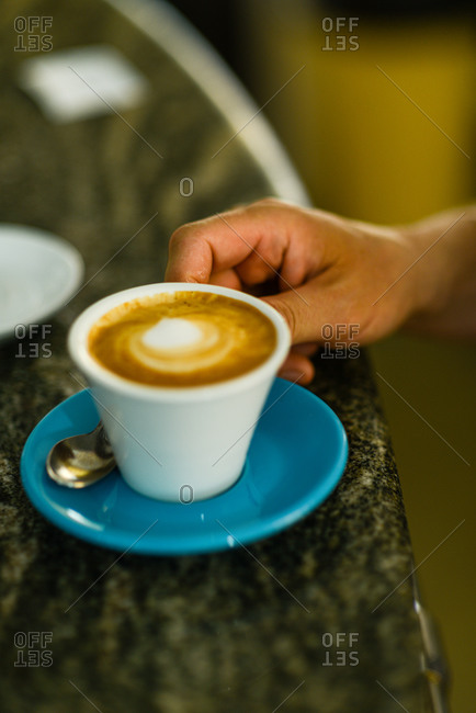 Man holding cup of Espresso coffee cappuccino close up overhead s