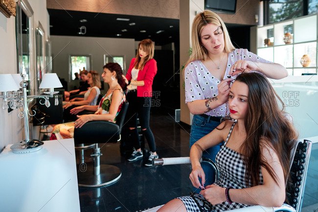 Female clients at a hair salon - small business concept