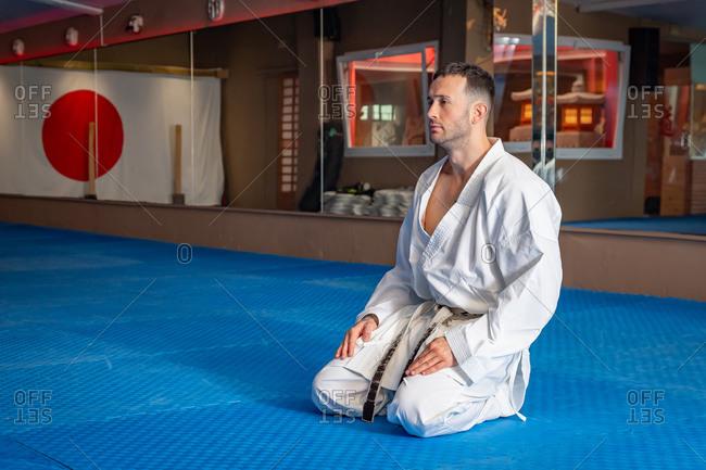 Karate man with traditional Japanese sitting posture on tatami