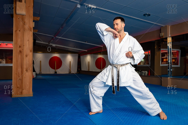 Karate man stand your ground on tatami doing 'Empi Waza'