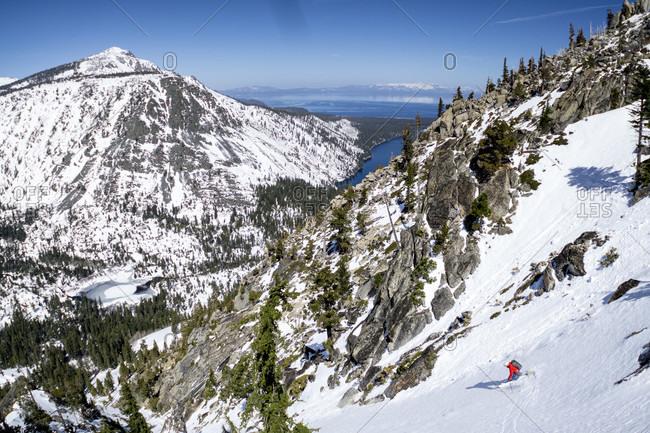 Mid forties man skiing down backcountry at Washington Pass