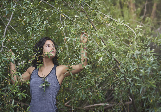 Woman among the vegetation of a river.