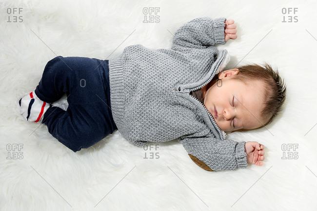 Newborn baby asleep with a pacifier