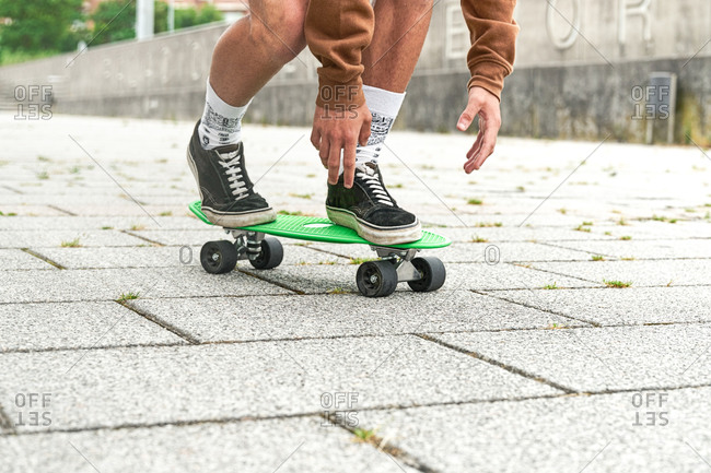 Close-up of Skateboarder doing a trick at the park. Concept of leisure activity, sport, extreme, hobby and motion.
