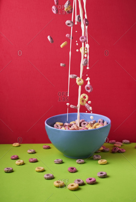 milk with colored cereals flying