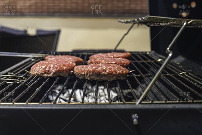 Hamburgers on the barbecue. Close-up view.