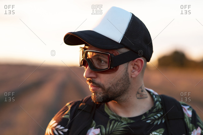 Man with aviator glasses in nature, concept of starting a new adventure