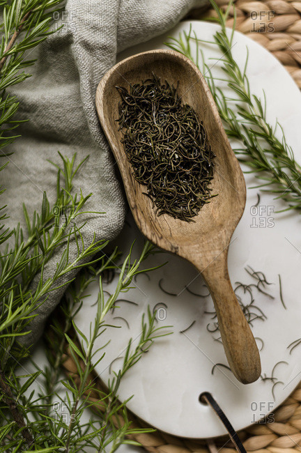 Dried Rosemary in Wooden Scoop