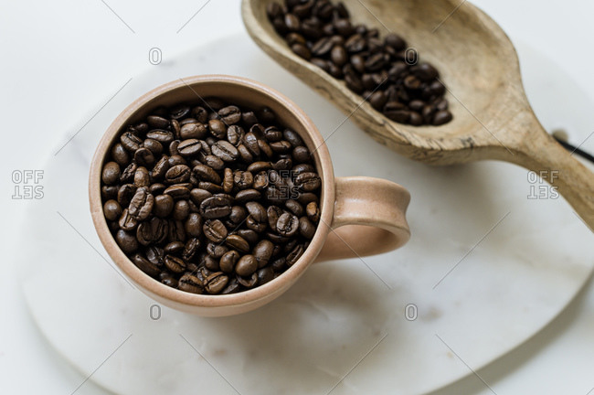 Coffee Mug and Wooden Scoop with Whole Coffee Beans