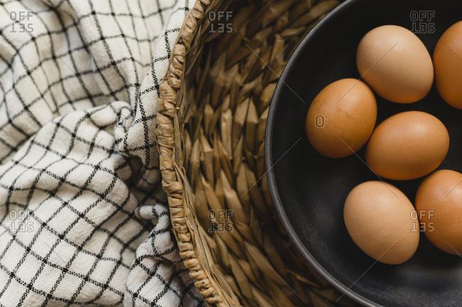 Organic Brown Eggs in Brown Bowl and Basket