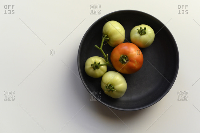 Minimalistic Homegrown Tomatoes in Black Bowl