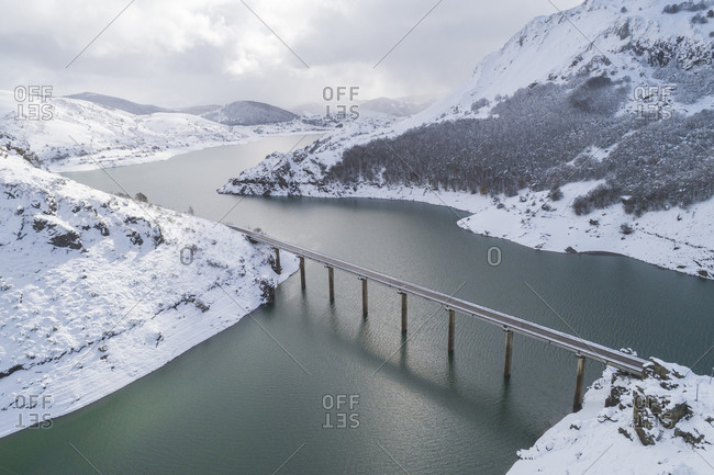 Snowy reservoir from aerial view