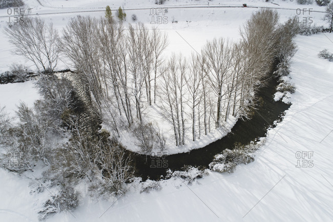 snowy curve of river from aerial view