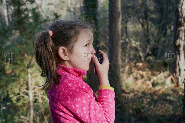 Girl with radio set in forest