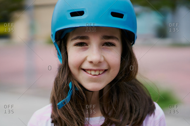 Portrait of girl with blue helmet