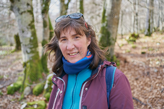 Portrait of a sheltered woman walking in a forest in autumn
