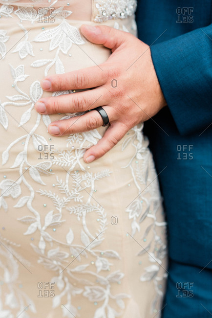 Close up shot of a man wearing his wedding ring at his wedding