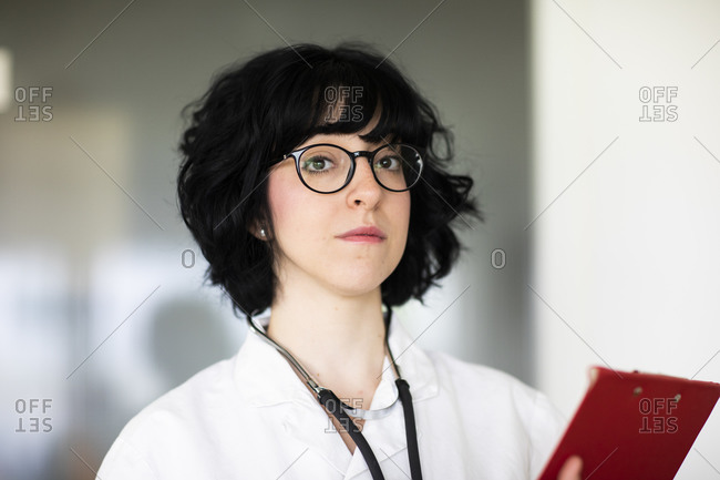 Young female doctor with white coat