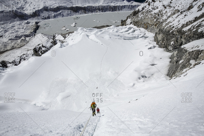 Climbers descend from the summit of Nepal's Island Peak, near Everest.