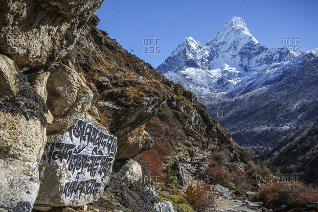 Buddhist script below the peak of Ama Dablam on the trail to Everest.