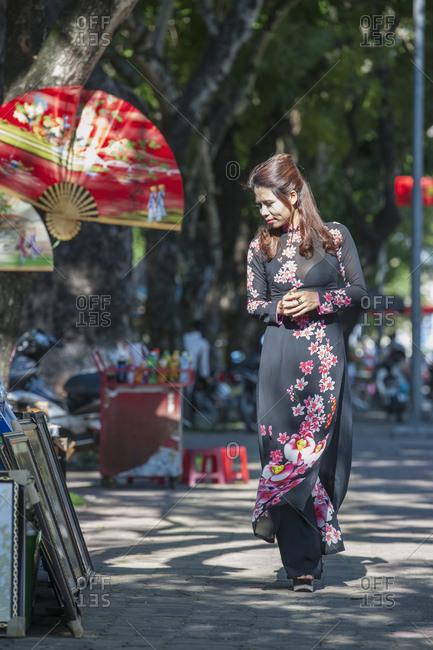 Beautiful woman browsing street market  in Hue / Vietnam